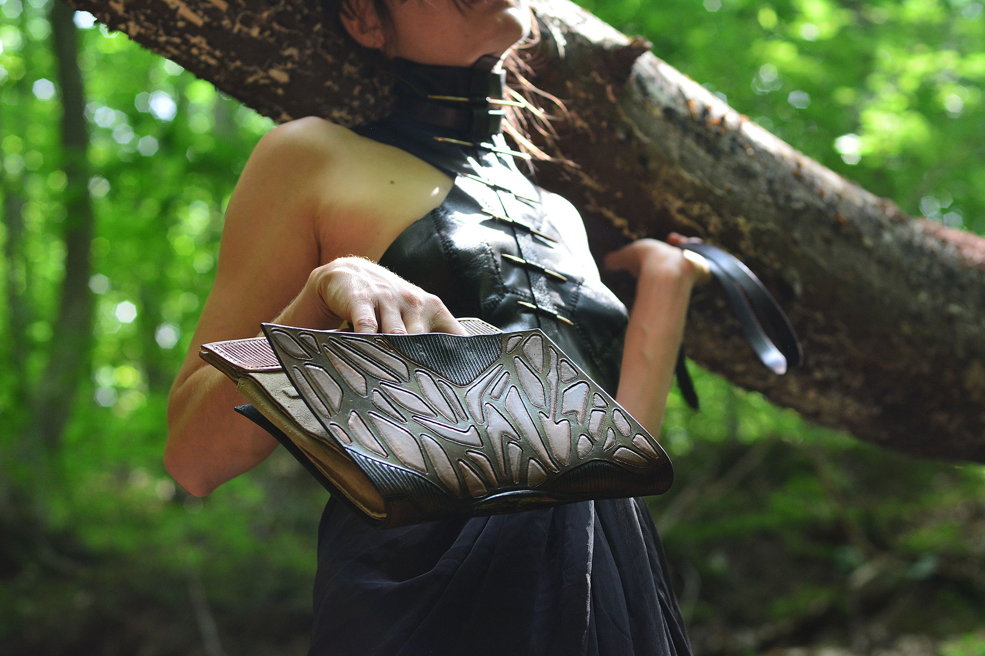 sculptured leather clutch